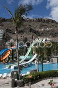 Water slide in a seawater bath in Taurito Stock Photos