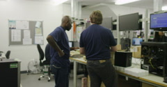 Workers building computers in a British electronics factory Stock Footage