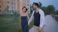 Happy couple newlyweds fun stroll along the promenade near his new home Stock Footage