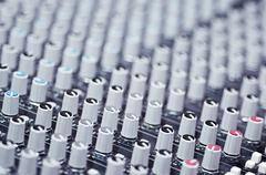 Closeup mixing faders and knobs as seen from above side angle, artistic studio Stock Photos