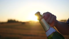 A guy opens a bottle of champagne Stock Footage