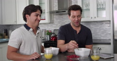 Man feeds his boyfriend a raspberry at breakfast, shot on R3D Stock Footage