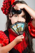 Cute little girl wearing beautiful red and black dress with matching head band Stock Photos