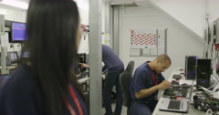 Portrait of cheerful female worker in an electronics factory Stock Footage