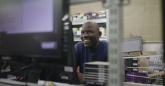 Portrait of cheerful male worker in an electronics factory Stock Footage