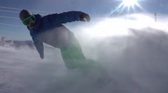 SLOW MOTION: Snowboarder spraying freshly groomed snow on mountain ski slope Stock Footage