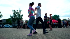 Young people dancing salsa near the fountain at sunset Arkistovideo