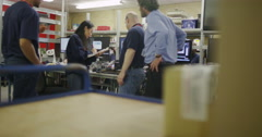Workers in a team meeting in electronics factory Stock Footage