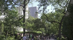 New York City, Central Park Wildlife Center, trees and skyscrapers Stock Footage