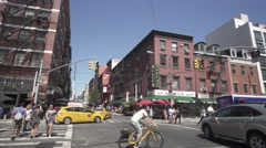 New York City, Little Italy sign, shops, tourists, taxi and restaurants Stock Footage
