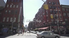 New York City, Little Italy sign, shops, tourists and restaurants Stock Footage