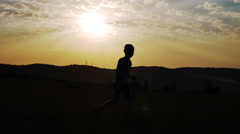 Silhouette of a Boy on a Background of the Sun Dancing Funny Dance Stock Footage
