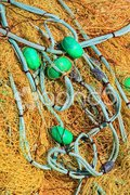 Pile yellow fishing net Stock Photos