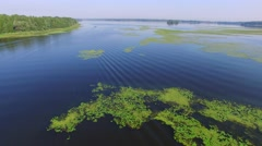Flying backward over the river delta Stock Footage