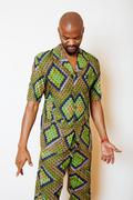 Portrait of young handsome african man wearing bright green national costume Stock Photos