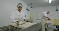 Fish workers at a seafood processing plant Stock Footage