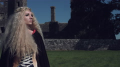 4k Medieval Shot of Game of Thrones Style Queen Posing, Castle in Background Stock Footage