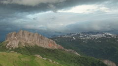 Movement of clouds over the summer slopes of Caucasus Mountains Stock Footage