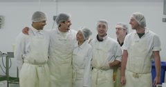 Portrait of cheerful worker in a seafood processing factory Stock Footage