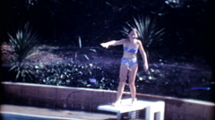 Young girls on the diving board in backyard pool 3570-vintage film home movie Stock Footage