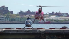 Red Helicopter Departs NYC Heliport Stock Footage