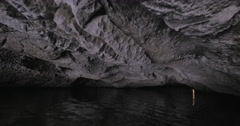 In Halong Bay in Hanoi, Vietnam seen river and grotto Stock Footage