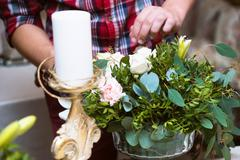 The decor for the wedding photo shoot.  arrangement on the table and hands Stock Photos