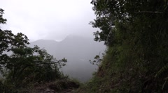 View looking through valley filled with fog Stock Footage