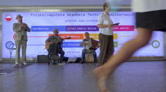Jazz group in a busy subway hallway, crowd of people. Warsaw, Poland - Timelapse Stock Footage