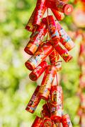 Red chinese New Year decorations. Symbols of luck and protection. Thailand. Stock Photos