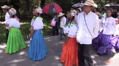 Panamanian children dressed up, twirling skirts walking down street Stock Footage