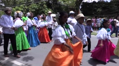 Panamanian girls dancing, waving skirts walking down the street Stock Footage