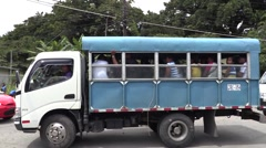 People crowding in blue truck/bus Stock Footage