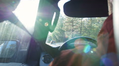 Driving into sunlight on a rural road, rear passenger's POV, shot on R3D Stock Footage