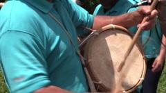 Closeup of man beating drums Stock Footage