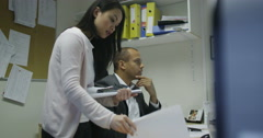 Office employees working together in modern building Stock Footage