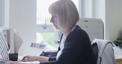 Office employee at work in modern building Stock Footage
