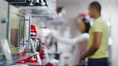 Couple shopping in a shop selling kitchen appliances. White goods and Stock Footage