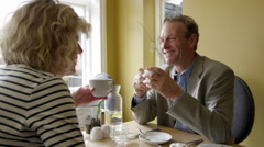 Senior Couple Drinking Coffee In Boutique Hotel Shot On R3D Stock Footage