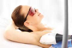 Beauty clinic, laser hair removal. Stock Photos