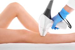 Laser hair removal legs Stock Photos
