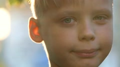 Close up portrait of happy funny cute kid standing in front of camera smiling Stock Footage