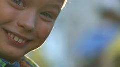 Close up profile portrait of little kid staying in children public playground Stock Footage