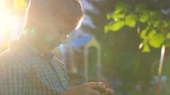 Closeup portrait of little kid holding smartphone with touchscreen in hands Stock Footage