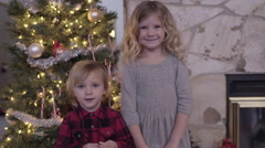 Portrait Of Brother And Sister, Standing Next To Christmas Tree And Smiling Stock Footage