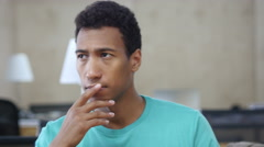 Thinking Pensive Black Young Man in Office, Portrait Stock Footage