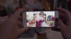 Mom Takes A Christmas Video Of Her Children Hugging By Cozy Fireplace Stock Footage