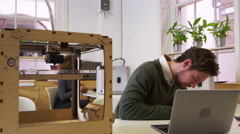 Designer working in a 3D printing lab, shot on R3D Stock Footage