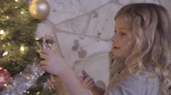 Excited Little Girl Decorates Christmas Tree, And Sings Christmas Carols Stock Footage