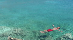 Vacation relaxation floating on crystal clear sea water Stock Footage